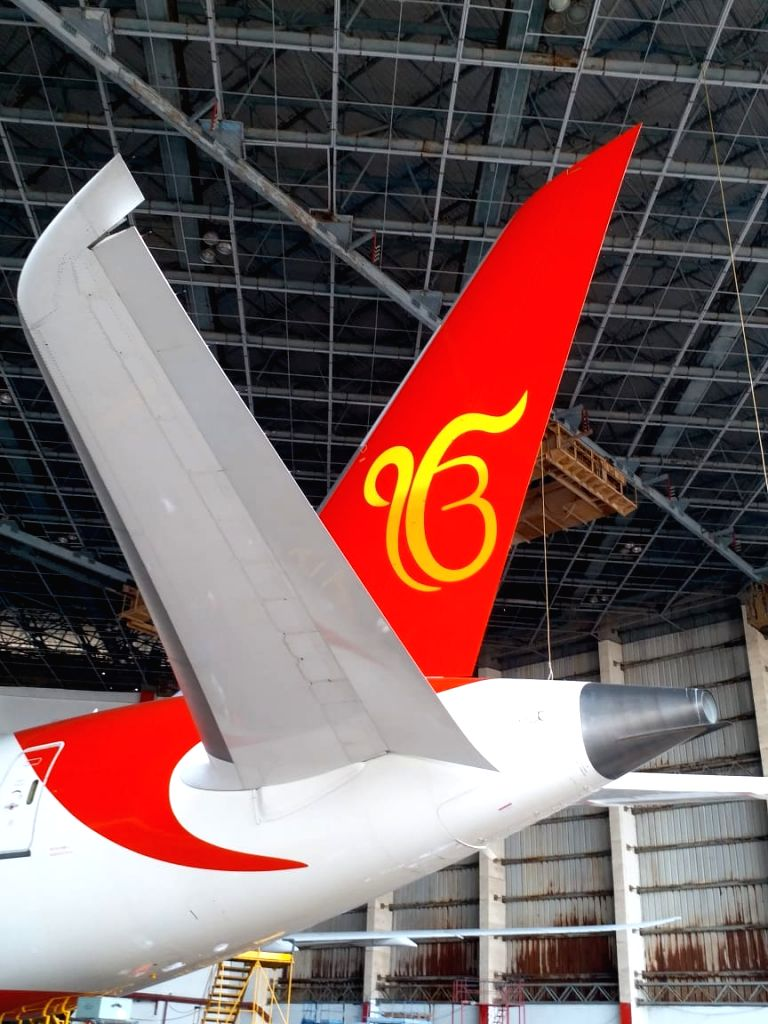 """An Amritsar to Stansted, UK, Boeing 787 Dreamliner aircraft sporting the scared symbol of """"Ek Onkar"""" on its tail wing, that will be launched by Air India from Amritsar on October ..."""