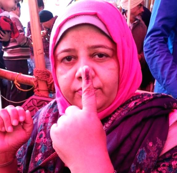 An anti-CAA protester shows her inked finger after casting her vote for the Delhi Assembly elections 2020, at Delhi's Shaheen Bagh on Feb 8, 2020.
