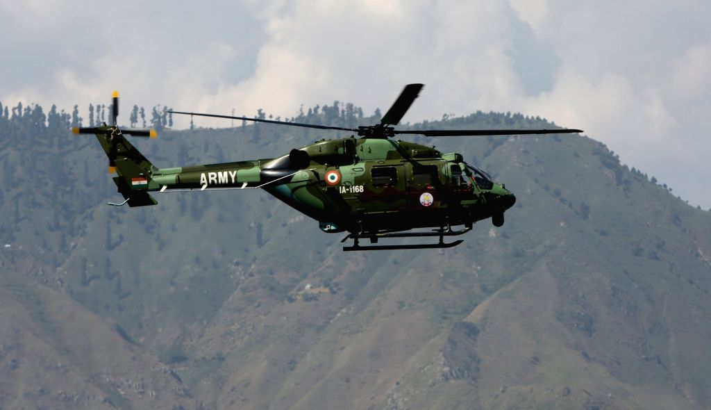 An army helicopter approaches Uri army camp that was attacked by terrorists on Sept 18, 2016.
