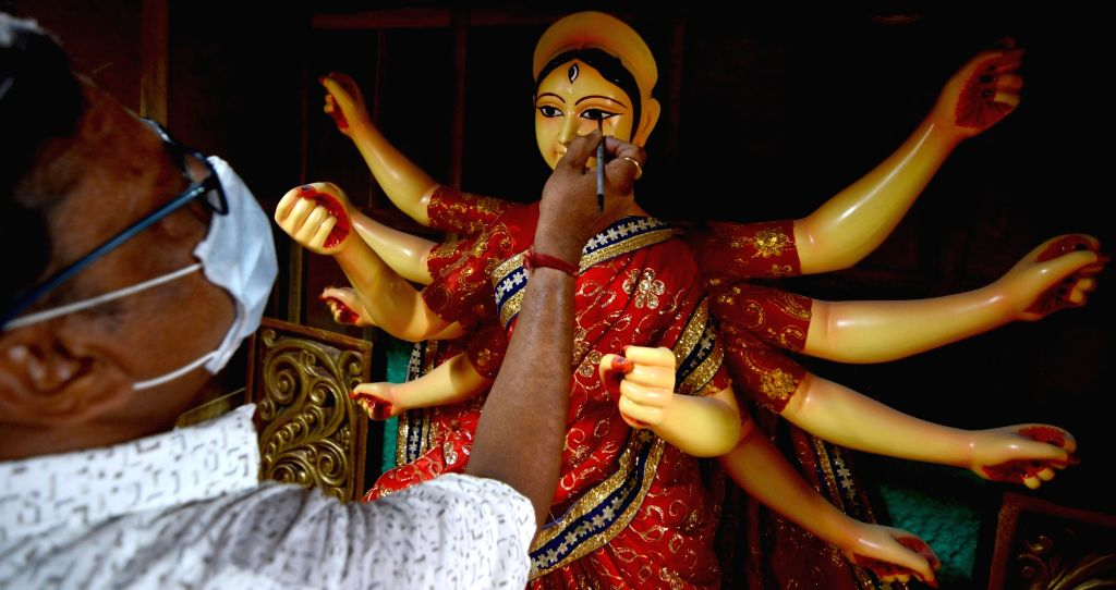 An artist busy giving finishing touches to an idol of Goddess Durga at Kumartuli workshop which shall be shipped to Austria, in Kolkata on Aug 13, 2020.