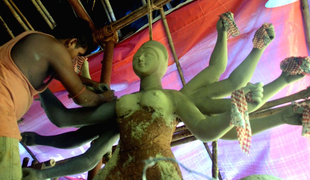 An artist busy making a Durga idol ahead of Navratri in Mumbai, on Sept 26, 2016.