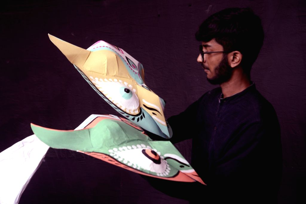 An artist busy making masks for Mangal Sobha Yatra ahead of Bengali New Year in Kolkata, on April 10, 2019.