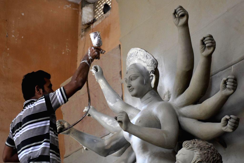 An artist busy painting a Durga idol ahead of Navratri in Jaipur, on Sept 26, 2016.