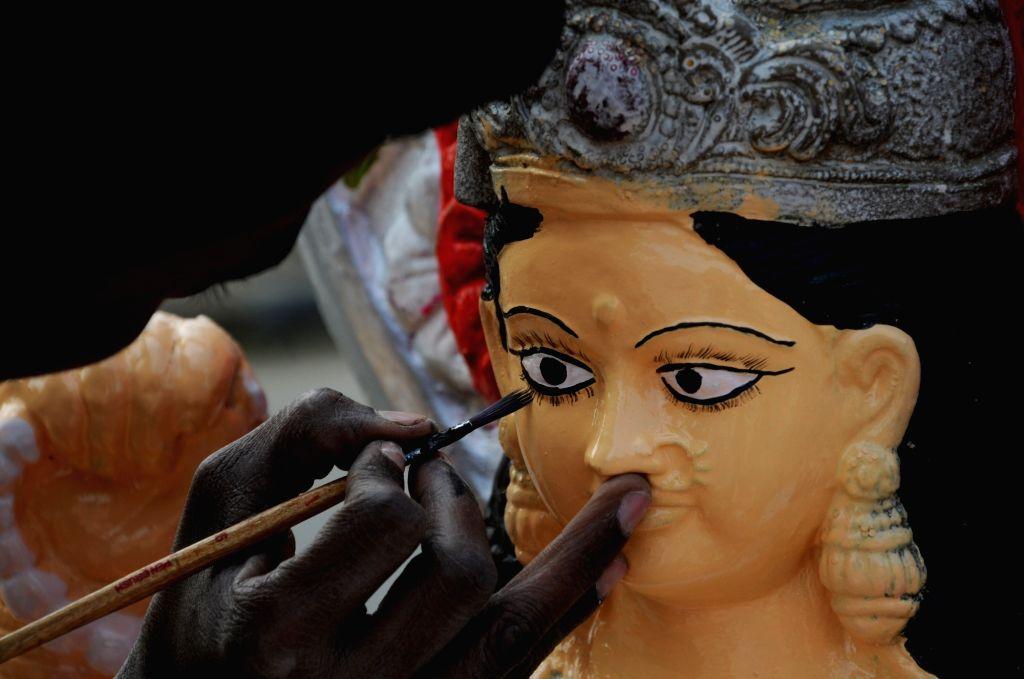 An artist busy painting an idol of goddess Saraswati ahead of Saraswati puja in Amritsar on Feb 8, 2019.