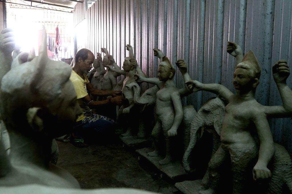 An artist busy preparing an idol of Goddess Durga ahead of Durga Puja celebrations, at a workshop in Chennai on Sep 13, 2019.