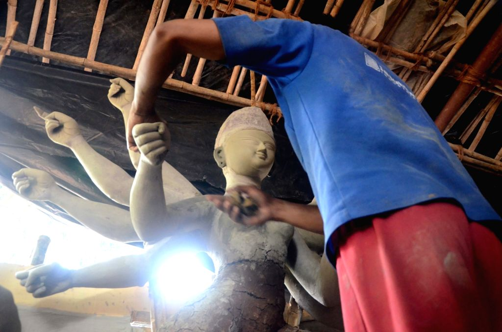 An artist busy preparing goddess Durga idol ahead of Durga Puja in Mumbai on Sept 11, 2017.