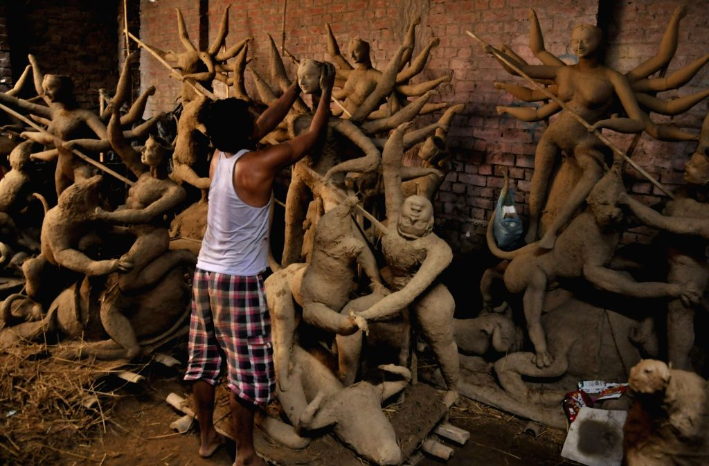 An artist busy preparing goddess Durga idol ahead of Durga Puja in Amritsar on Sept 11, 2017.