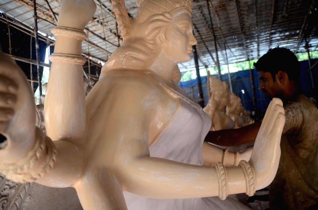 An artist busy preparing goddess Durga idol ahead of Durga Puja in Mumbai on Sept 12, 2017.