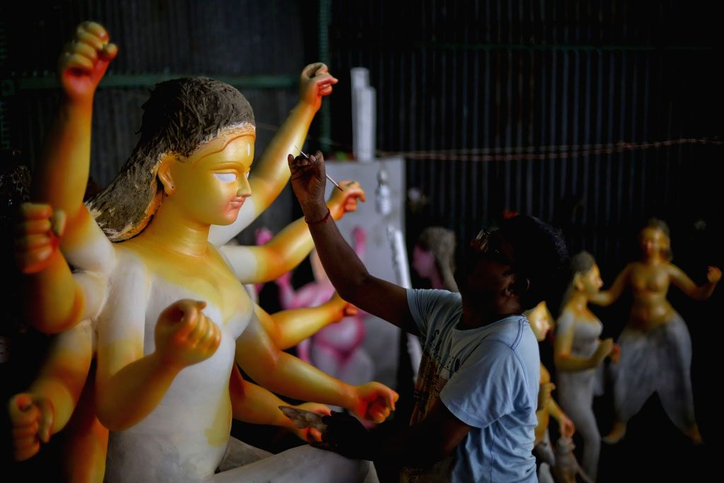 An artist busy preparing goddess Durga idol ahead of Durga Puja in Dhaka, Bangladesh on Sept 12, 2017.