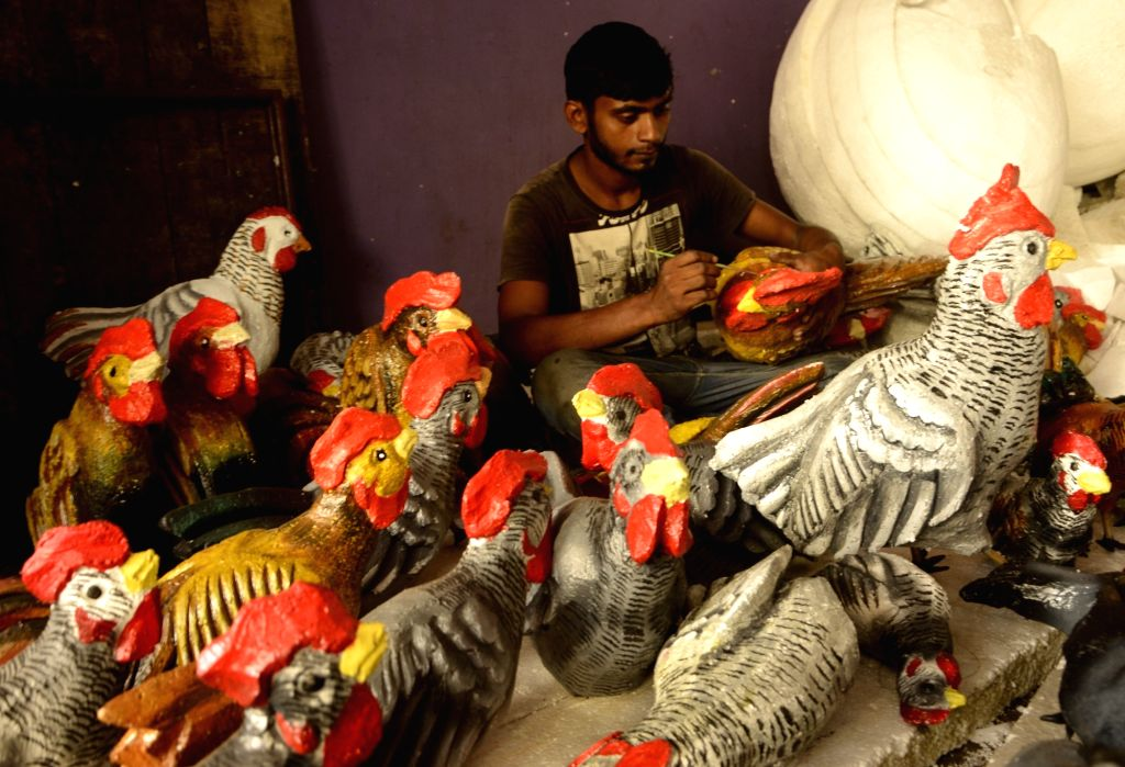 An artist busy working at Shyamal pally community Durga puja pandal on the eve of Durga Puja celebrations, in Kolkata on Oct 14, 2020.