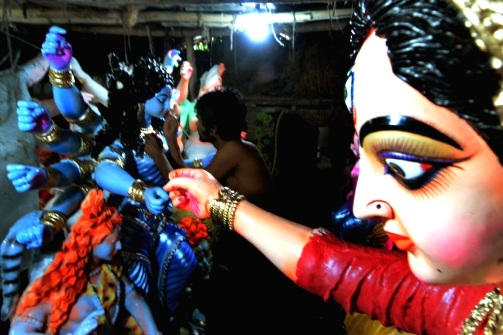 An artist gives finishing touch to the idols ahead of Durga Puja in Chittagong, Bangladesh on Sept 18, 2017.