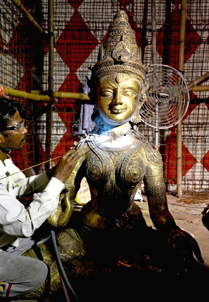 An artist gives finishing touches to a brass idol of Goddess Durga at an under construction puja pandal ahead of Durga Puja celebrations, in Kolkata on Sep 24, 2019.