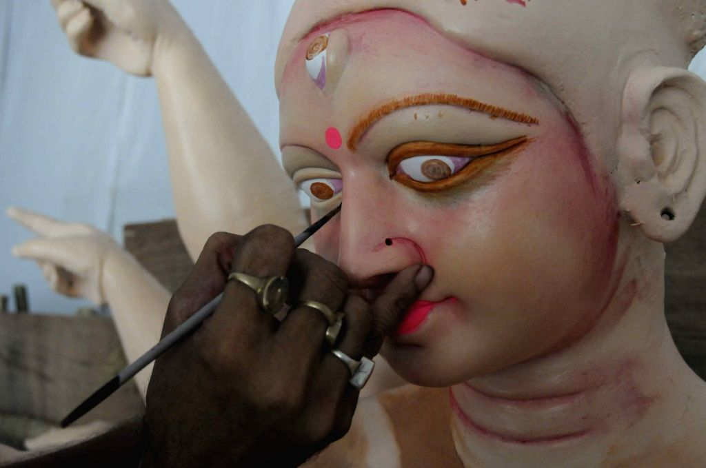An artist gives finishing touches to a Durga idol at a Patna workshop on Oct 4, 2016.