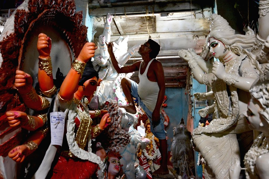 An artist gives finishing touches to a Durga idol at a Kumartuli workshop ahead of Durga Puja, in Kolkata, on Sep 22, 2019.