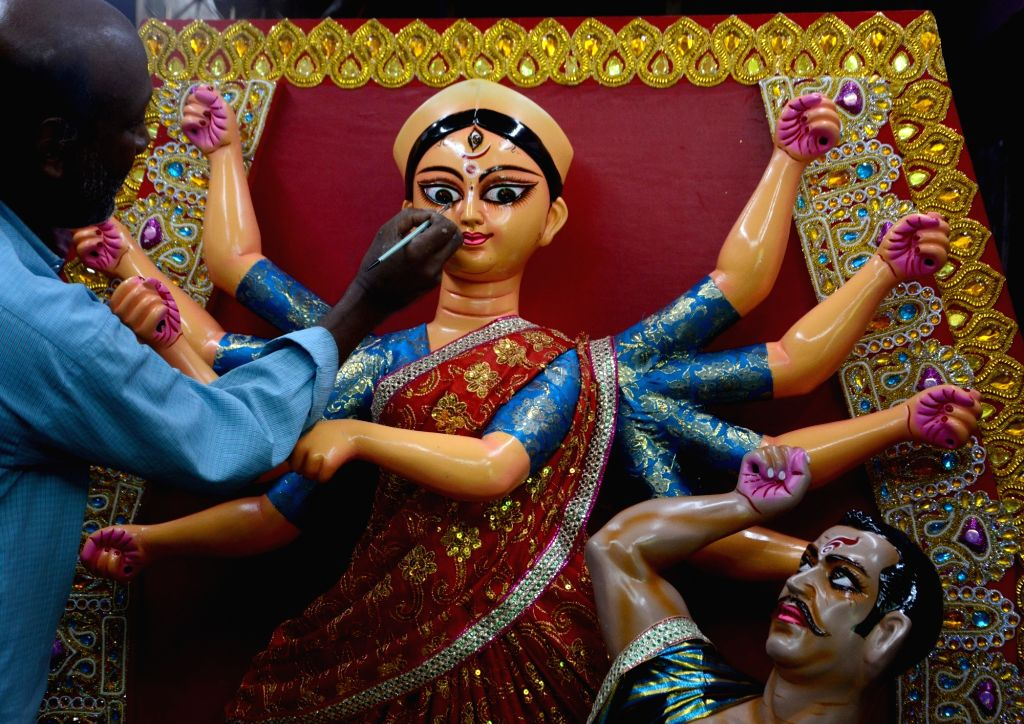 An artist gives finishing touches to an idol of Goddess Durga that is on its way to the USA, at the Kumartuli workshop in Kolkata Jul 5, 2020.