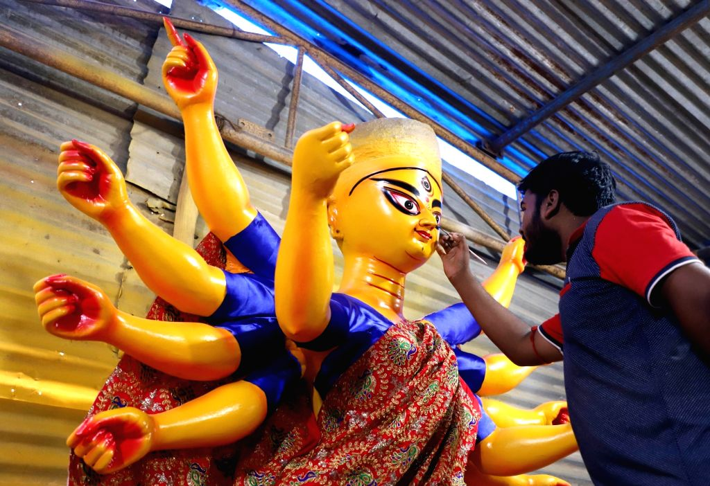 An artist gives finishing touches to an idol of Goddess Durga ahead of Navratri celebrations, in Bengaluru on Sep 27, 2019.