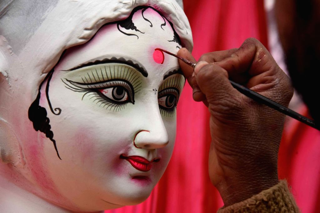 An artist gives finishing touches to an idol of Goddess Saraswati ahead of Saraswati Puja celebrations, in Patna on Jan 28, 2020.