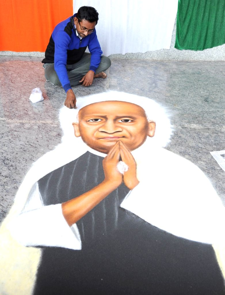 An artist gives finishing touches to his portrait of the country's first Home Minister Sardar Vallabhbhai Patel on the occasion of his birth anniversary in Bengaluru on Oct 31, 2018. - Sardar Vallabhbhai Patel