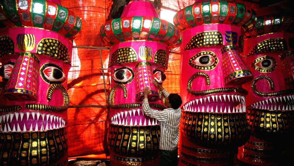 An artist giving final touches to an effigy of Ravana ahead of Dussehra in Mumbai on Oct 6, 2016.