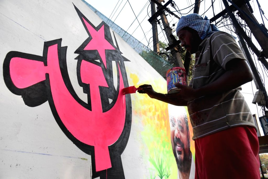 An artist paints a graffiti of a LDF candidate ahead of Lok Sabha Election 2019 in Kochi on March 10, 2019.