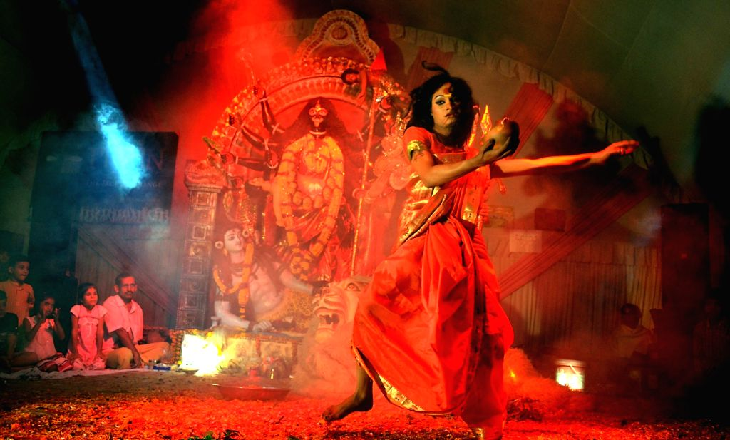 An artist performs during a programme at an Allahabad temple on Nov 14, 2015.