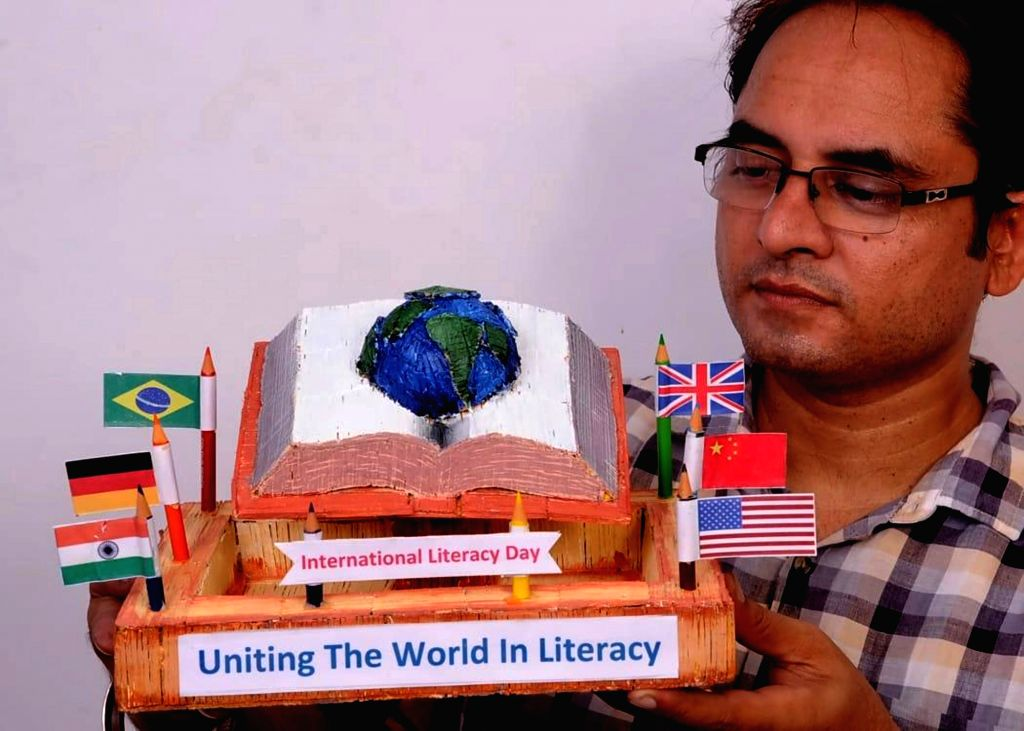 An artist showcases his creation made up of matchsticks on the eve of International Literacy Day, in Amritsar on Sep 7, 2019.