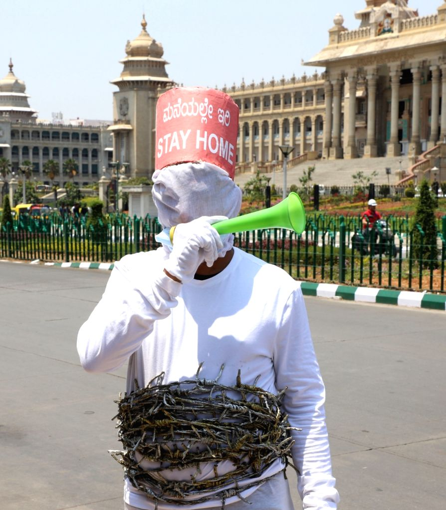 An artist spreads awareness on COVID-19 urging people to stay indoors ahead of Sunday's 'Janata Curfew' amid Coronavirus pandemic, in Bengaluru March 21, 2020.