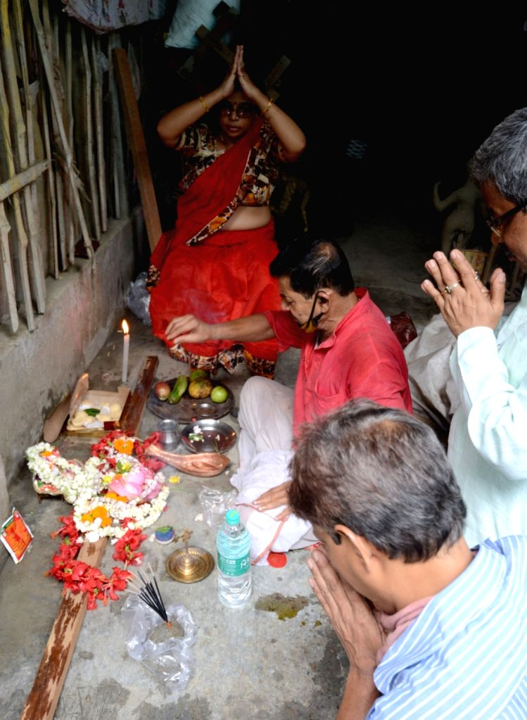 An artiste along with his family members, offers prayers to Goddess Durga on the occasion of Rath Jatra amid COVID-9 pandemic, at Kumartuli workshop in Kolkata on June 23, 2020.