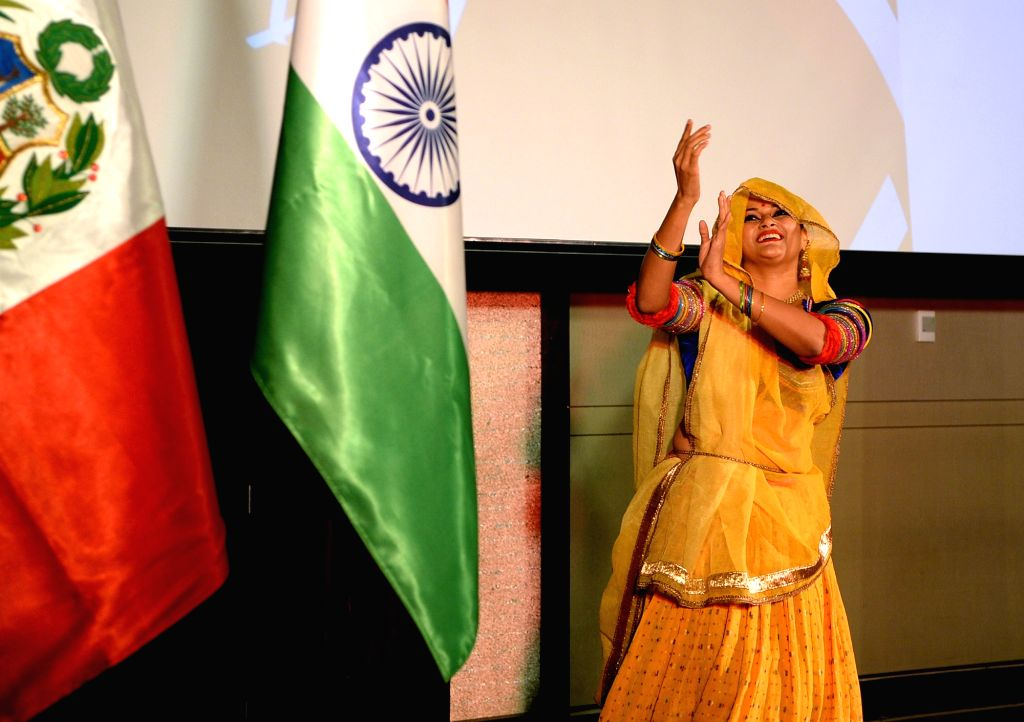 An artiste performs during a programme organised to celebrate the 198th anniversary of the Independence of the Republic of Peru, in Bengaluru on July 20, 2019.
