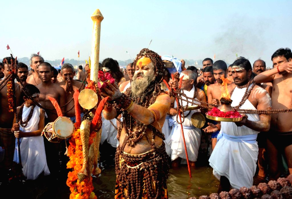 An ascetic performs rituals on Mauni Amavasya at Sangamthe confluence of the three holy rivers Ganga, Yamuna and the mythical Saraswati in Allahabad on Jan 16, 2018.