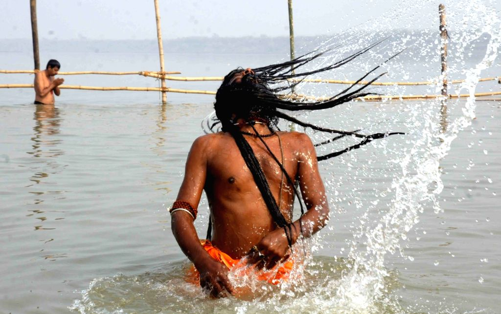 An ascetic take bath at the Ganga Ghats on the Nahai Khai (1st day of Chhath Puja) in Patna on Nov 15, 2015.