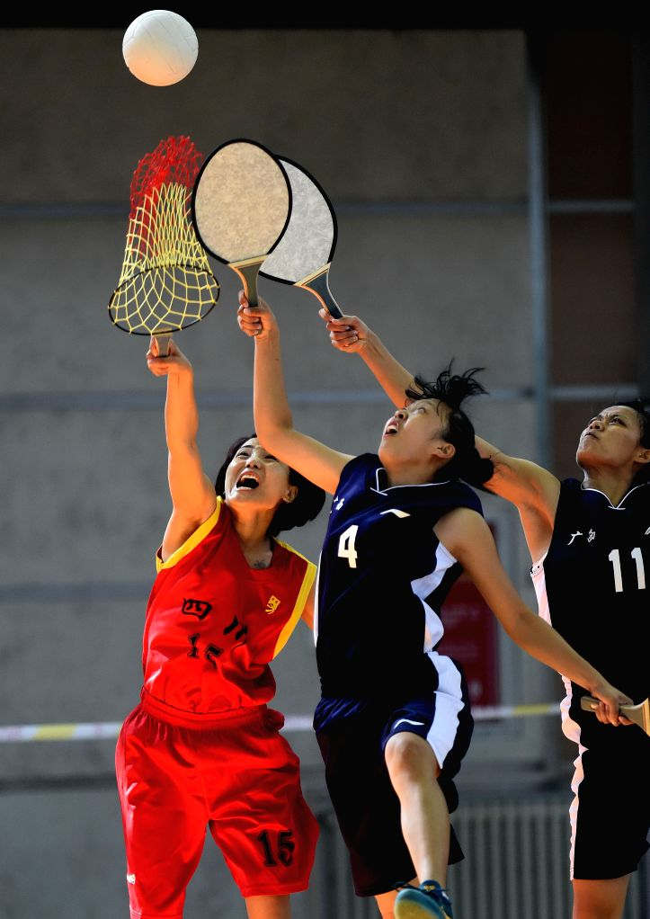 An athlete from southwest China's Sichuan Province (L) competes in the women's Pearl Ball final during the 10th National Traditional Games of Ethnic Minorities of ...