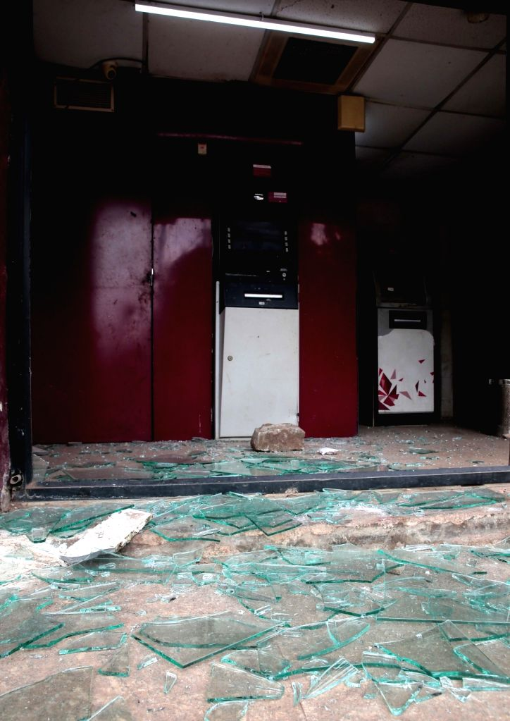 An ATM kiosk damaged by an irate mob during violence that erupted late on Tuesday night that resulted after an inflammatory social media post by Congress legislator Akanda Srinivas ... - B.