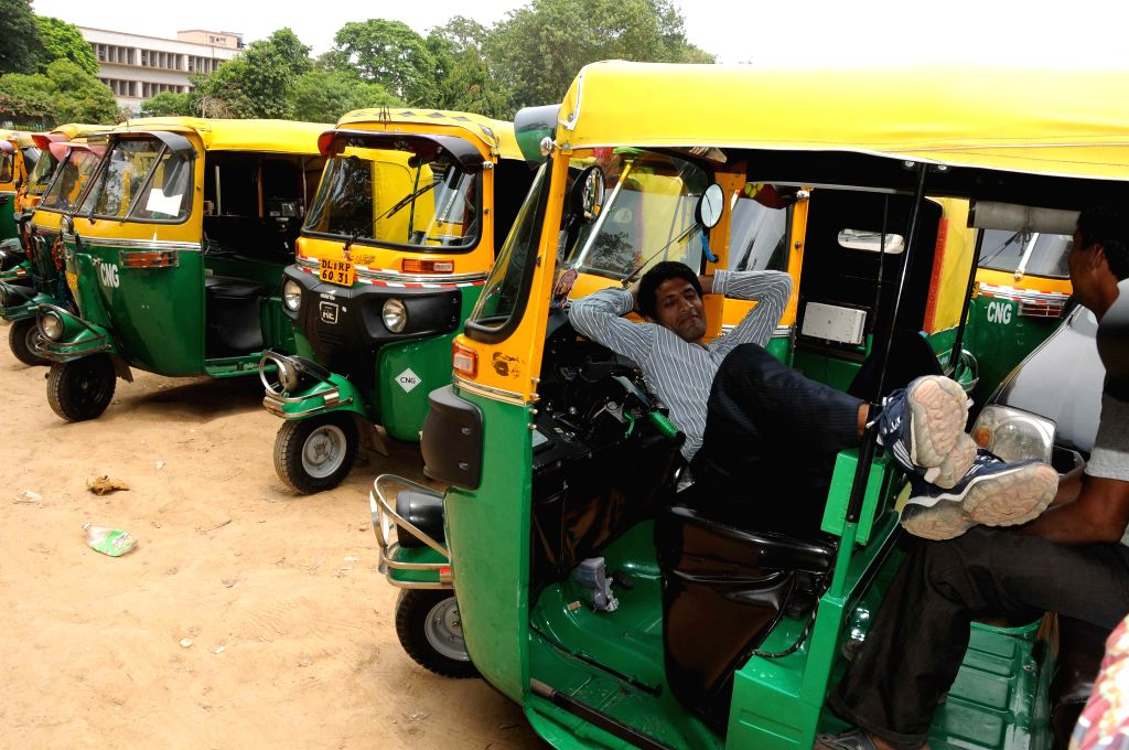 An auto-rickshaw driver enjoys a siesta as auto-rickshaws go on a day's strike against alleged highhandedness of traffic police and transport department in New Delhi on July 28, 2014.