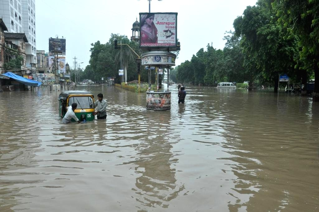 An auto rickshaw gets stuck in a flooded road of Baroda, Gujarat after heavy rains on Sept 10, 2014.