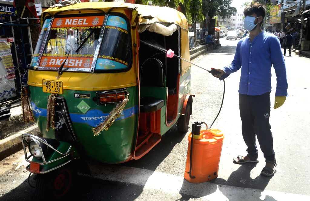 An Auto Union activist sanitises autos as a precautionary measure against COVID-19, amid Unlock 1.0 or phased relaxation during the fifth phase of the nationwide lockdown imposed to mitigate ...