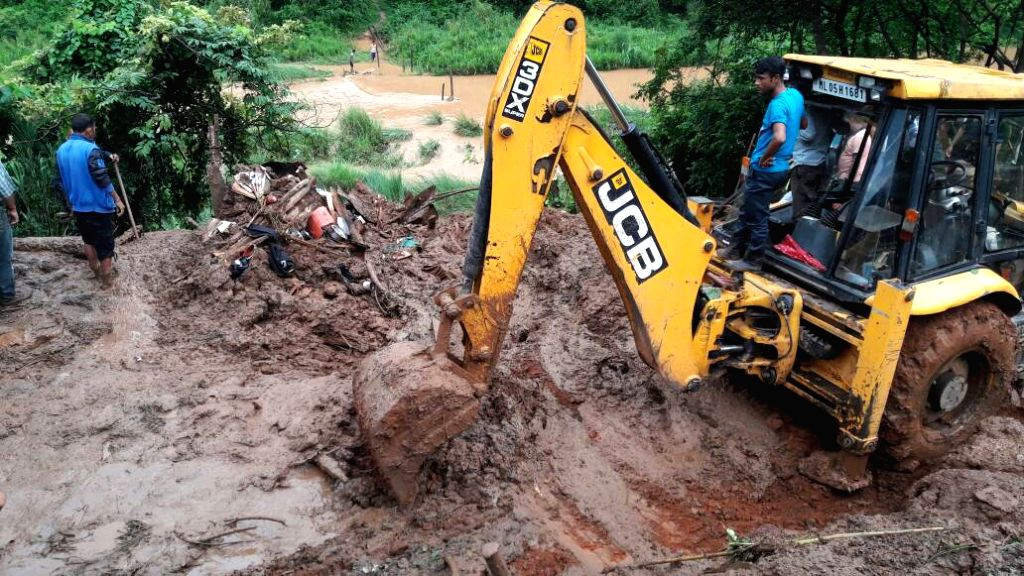 An earth-mover pressed into service after landslide caused by incessant rains in Thariavillage, Meghalaya on June 17, 2017.