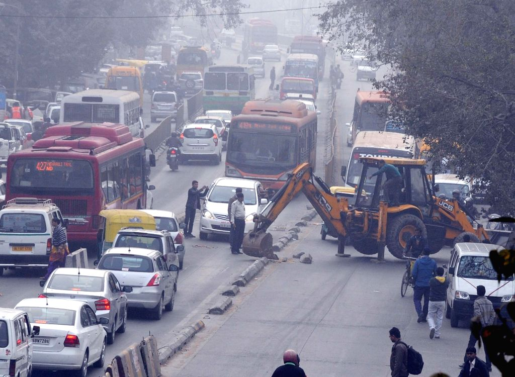 An earthmover involved in dismantling of Bus Rapid Transport corridor in Madangir of New Delhi on Jan 19, 2016.