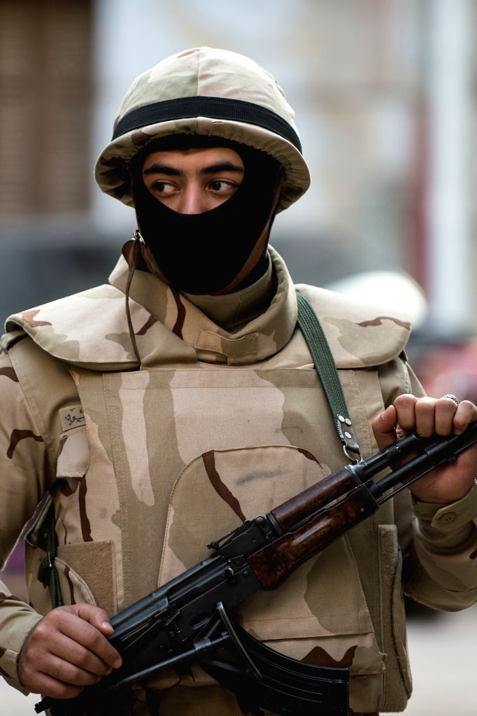 An Egyptian soldier stands guard at a polling station in Cairo, Egypt, on Nov. 22, 2015. Egyptians began voting Sunday in the second phase of the country's first ...
