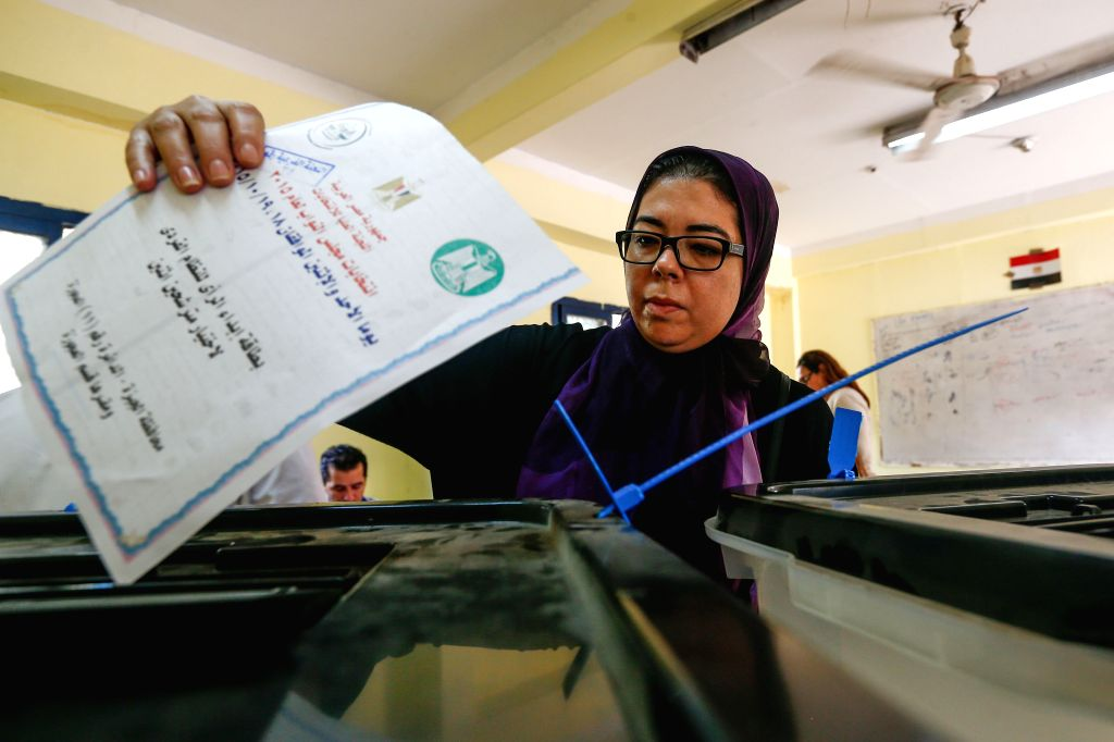 An Egyptian voter casts her ballot in a polling station in Giza, Egypt, on Oct. 18, 2015. Egyptians began voting Sunday in the country's first parliamentary election ...