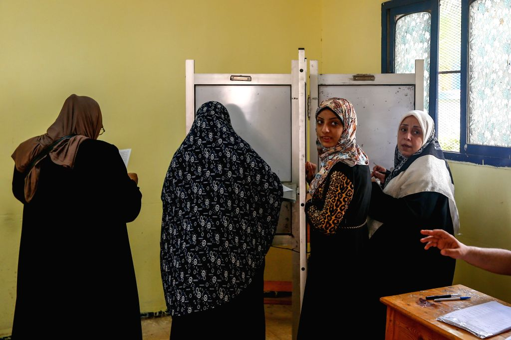 An Egyptian voter is seen guided by a soldier to enter a polling station in Giza, Egypt, on Oct. 18, 2015. Egyptians began voting Sunday in the country's first ...