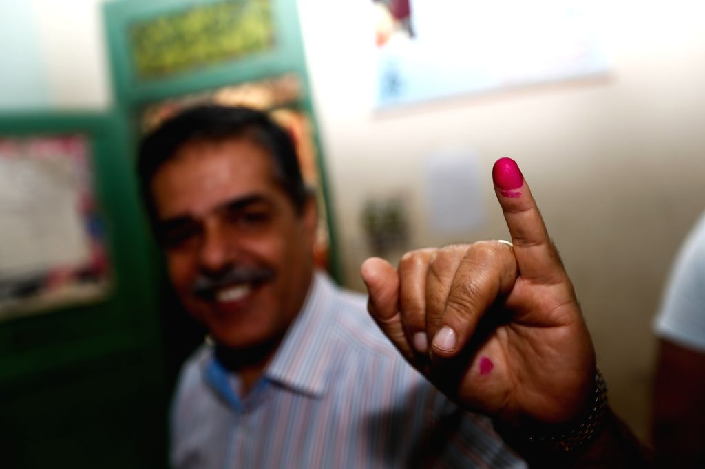 An Egyptian voter presents his red finger print after voting in a polling station in Giza, Egypt, on Oct. 18, 2015. Egyptians began voting Sunday in the country's ...