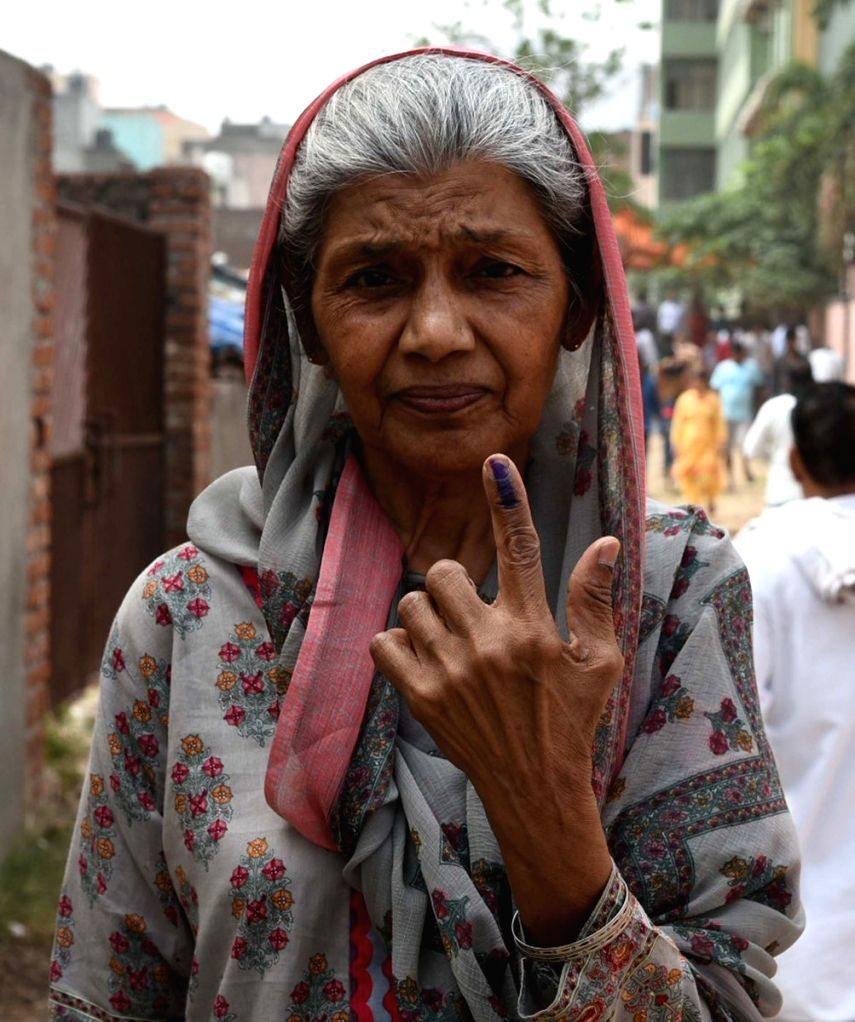An elderly lady shows her forefinger marked with indelible ink after casting vote during the sixth phase of 2019 Lok Sabha elections, in Delhi's Badarpur on May 12, 2019.