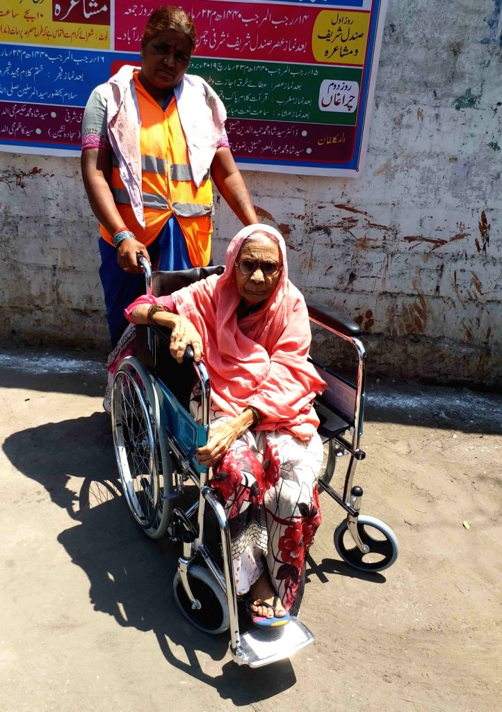 An elderly woman arrives to cast her vote during the 2019 Lok Sabha elections, at a polling booth in Hyderabad, on April 11, 2019. Polling was underway on Thursday for the 42 Lok Sabha ...