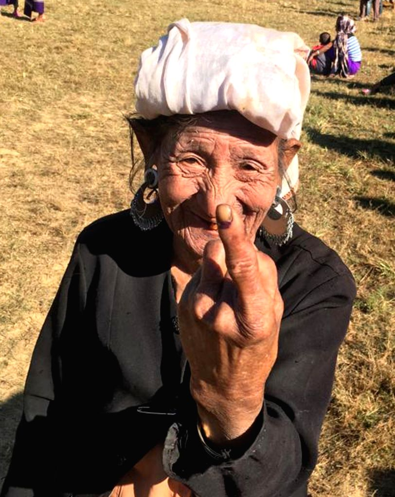 An elderly woman shows her inked finger after casting her vote for the Mizoram Assembly elections in Kanhmun, Mizoram on Nov 28, 2018.