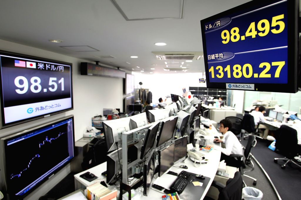 An electric board displaying the currency exchange rate of yen at Nikkei Stock Average in Tokyo. (File Photo: IANS))