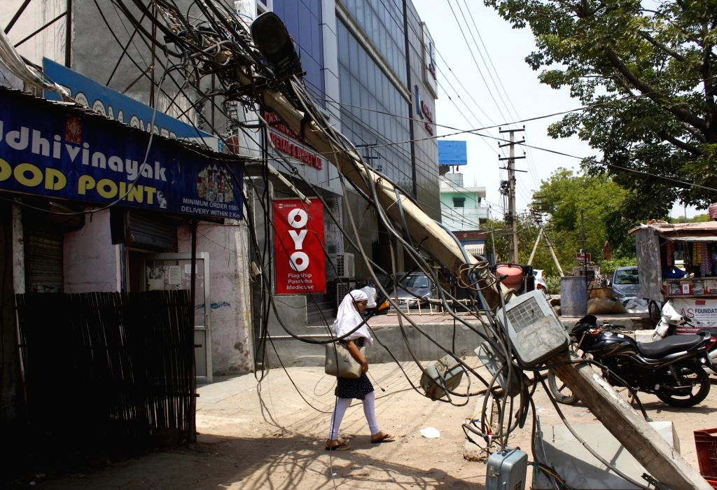 An electric pole that got damaged during a dust storm that hit Gurugram on June 13, 2019.