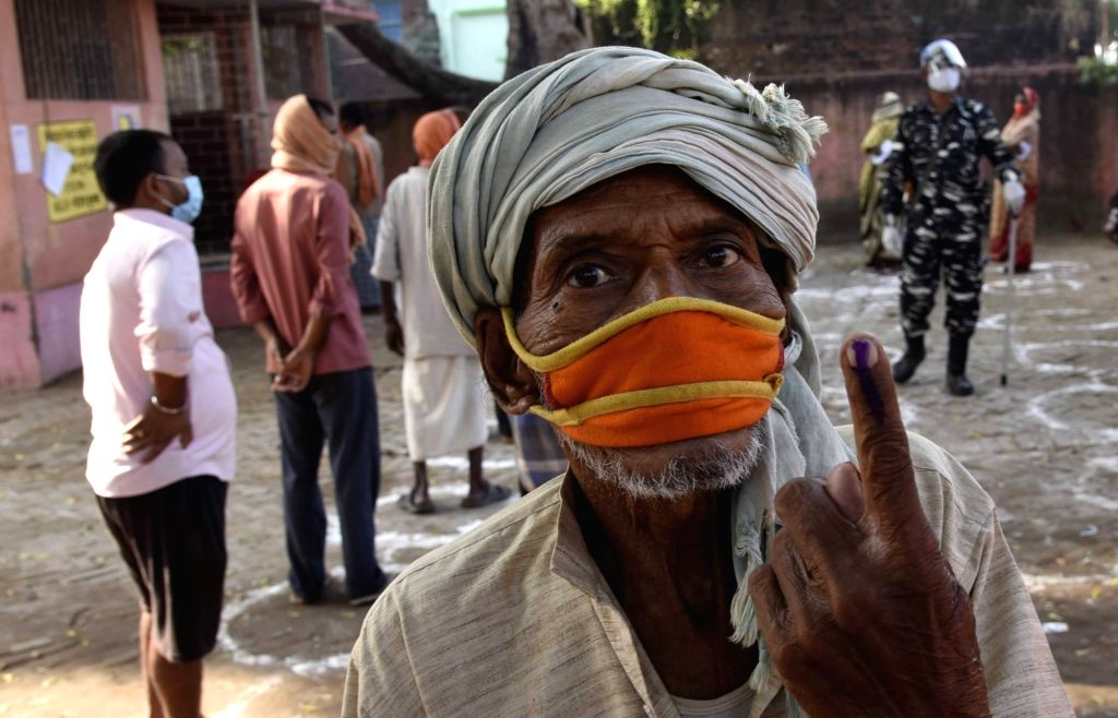 An elederly voter shows his inked finger after casting his vote for the first phase of Bihar Assembly elections, at Paliganj in Patna district on Oct 28, 2020.