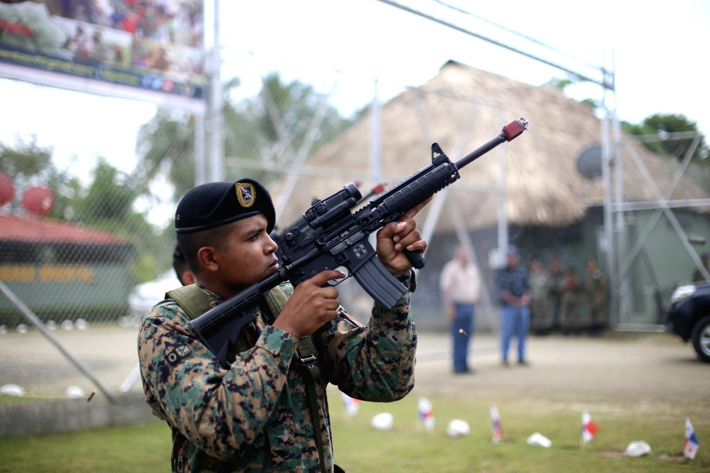 An element of the National Border Service (SENAFRONT), takes part in a graduation ceremony in Meteti village, Darien province, Panama, on Nov. 23, 2015. According to ...