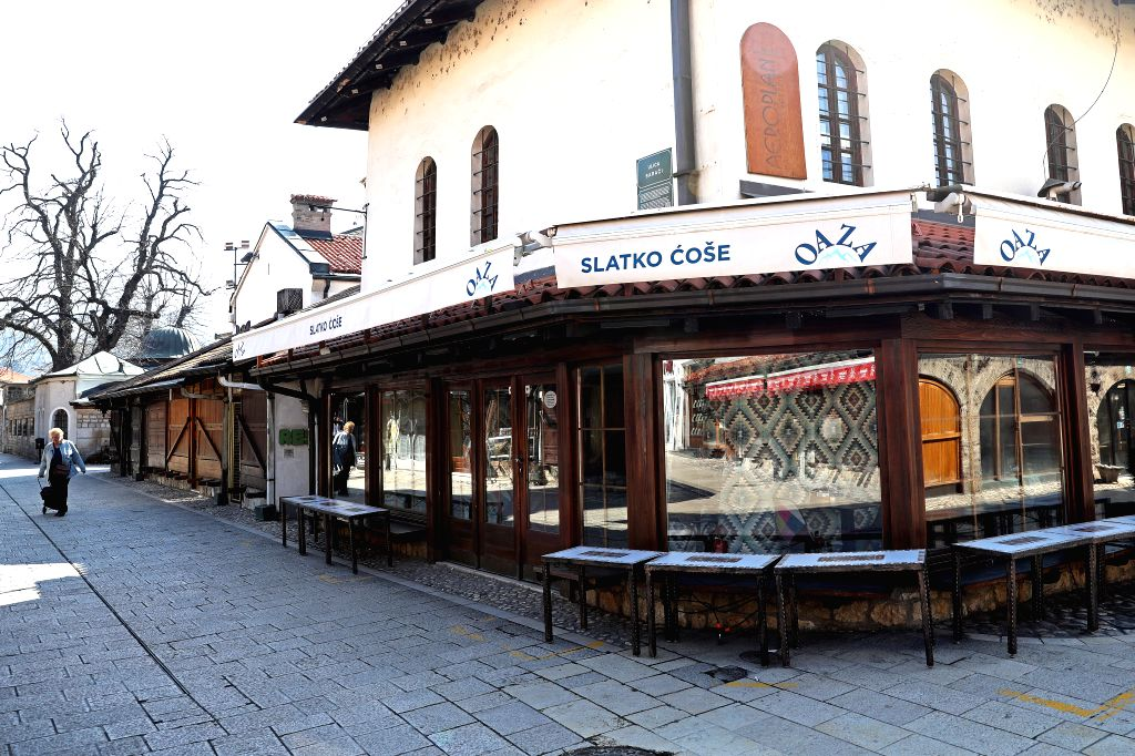 An empty cafe is seen in Sarajevo, Bosnia and Herzegovina (BiH) on March 18, 2020. Bosnia and Herzegovina (BiH) declared a state of emergency on Monday due to the ...